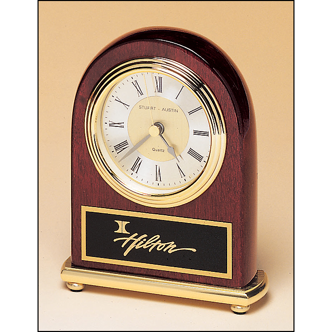 Rosewood stained piano finish clock on a brass base.