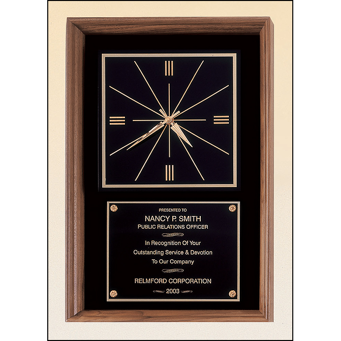 American walnut wall clock that can hang in either a vertical or a horizontal position.