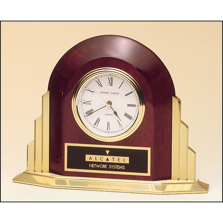 Rosewood stained piano finish desk clock with towering gold base.