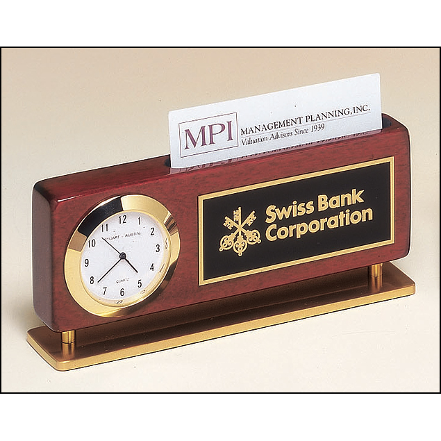 Rosewood stained piano finish combination clock and business card holder with gold metal accents.