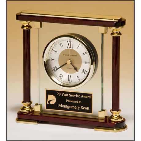 Traditional glass and rosewood piano-finish clockwith gold metal accents.