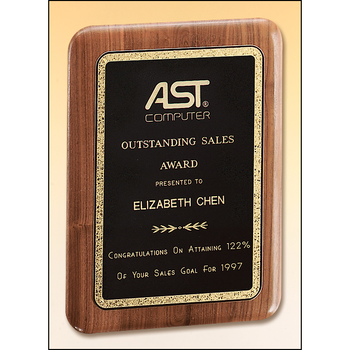 Solid American walnut plaque with a precision elliptical edge and a black brass plate with gold florentine border.