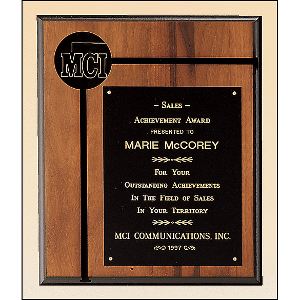 "Solid American walnut plaque with furniture finish and a 2 1/2"" diameter brass disc."