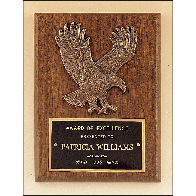 American walnut plaque with a sculptured relief eagle casting.