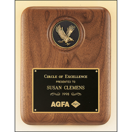 American walnut plaque with a finely detailed black and gold eagle medallion.