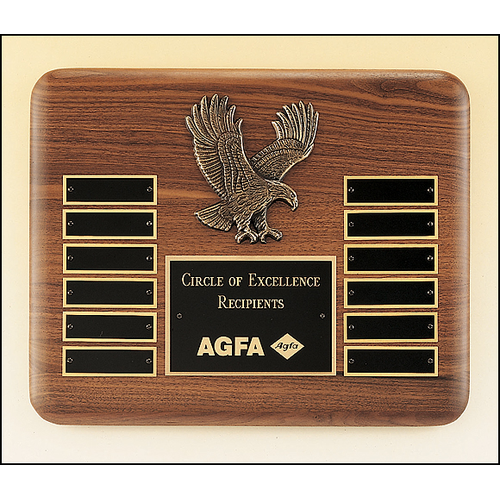 American walnut perpetual plaque with 12 black brass plates and a sculptured relief eagle casting.
