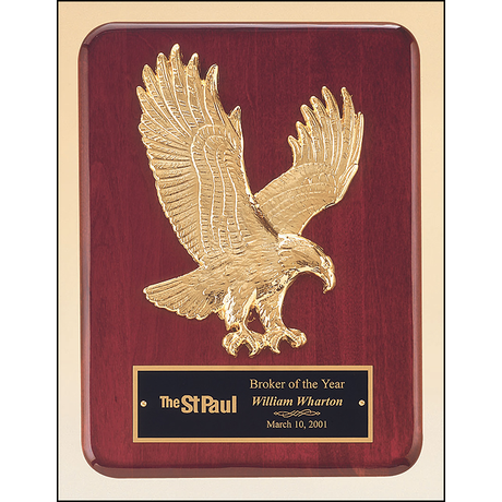 Rosewood stained piano finish plaque with goldtone finish sculptured relief eagle casting.
