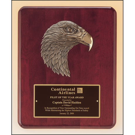 Rosewood stained piano finish plaque with antique bronze finish finely detailed eagle casting.