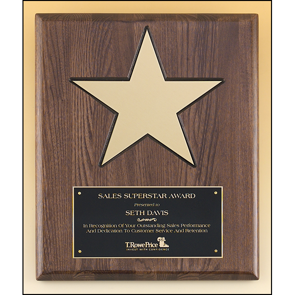 "Gold aluminum star (8"") on walnut stained  piano-finish board with black recessed area."