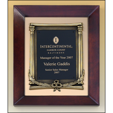 Cherry finish frame plaque with antique bronze finished frame on brushed metal gold background.