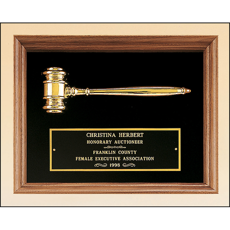 American walnut frame with a gold electroplated metal gavel on choice of velour backgrounds.