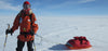 North Pole ski pulk expedition wearing Wintergreen Northern Wear. Quality outdoor apparel made in USA.