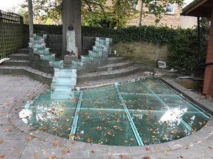Pond with structural glass cover
