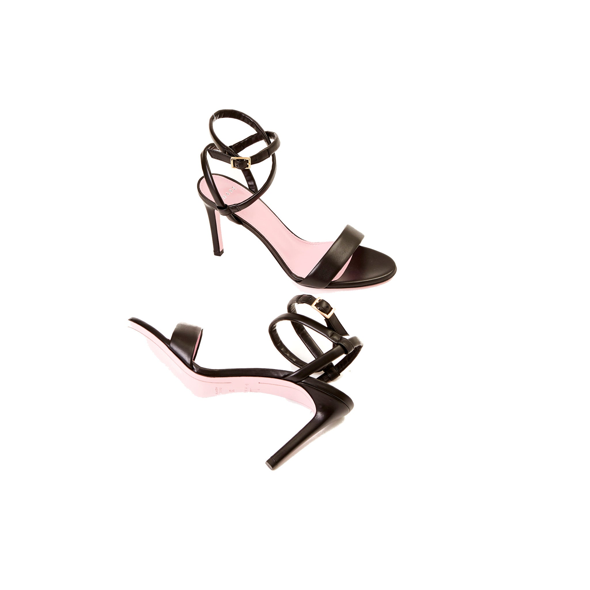Phare Wrap ankle strap high heel sandal in black leather sole view