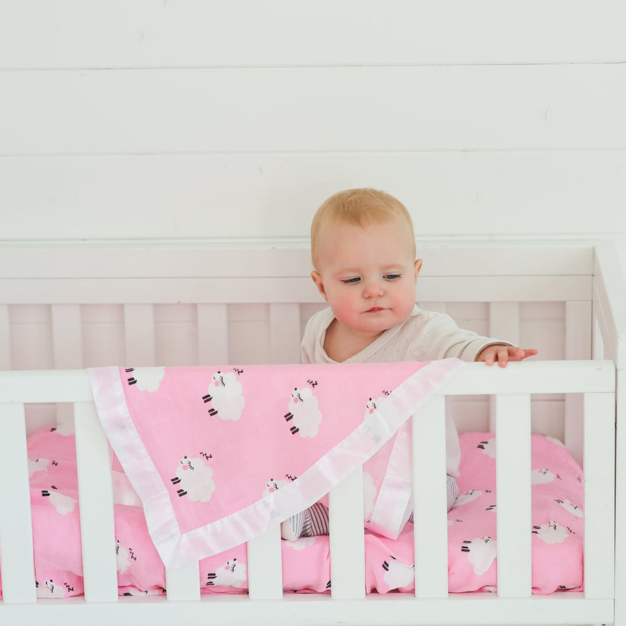 Pink cot sheets and bedding