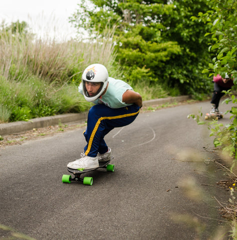 Arman Jabari going fast on a longboard