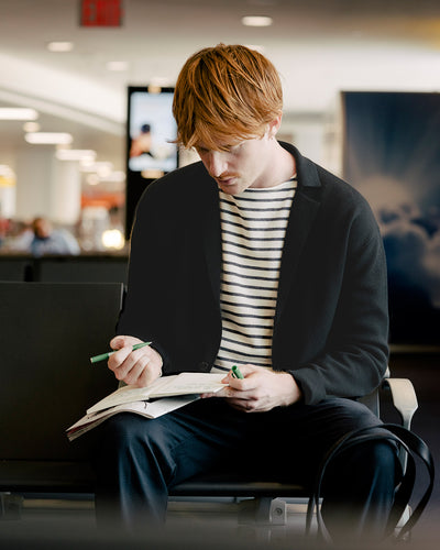 man waiting for his flight wearing ONS Clothing Fall 19 Collection's Cole Cardigan