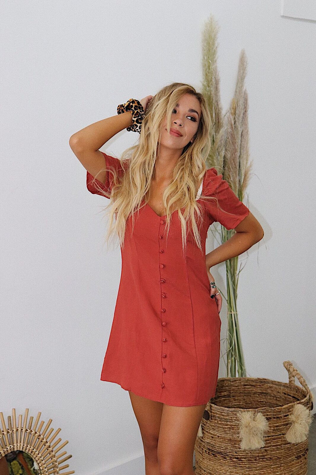 This burnt orange and red summer dress is one to remember.