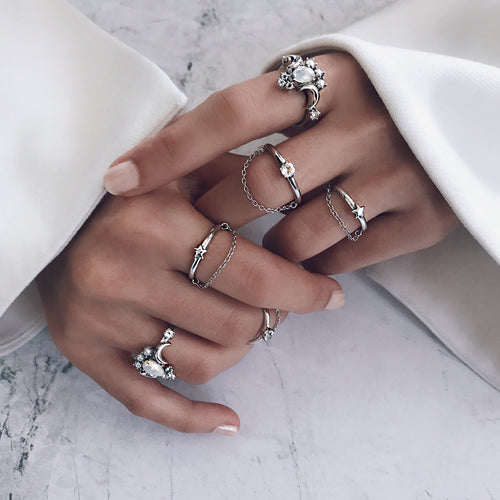 silver stacking white opal rings with stars, moons, shiny diamonds, fine chain rings in a gorgeous ring stack display