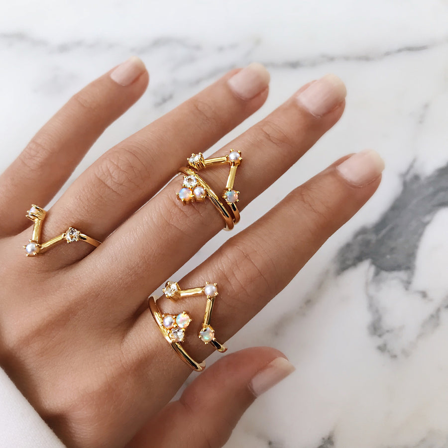 Opal gold ring set. Constellation V gold rings with Australian white opal, pearl and diamond stacked together. Double gold V rings that look good when worn.  Contemporary opal designer jewellery brand in Australia.