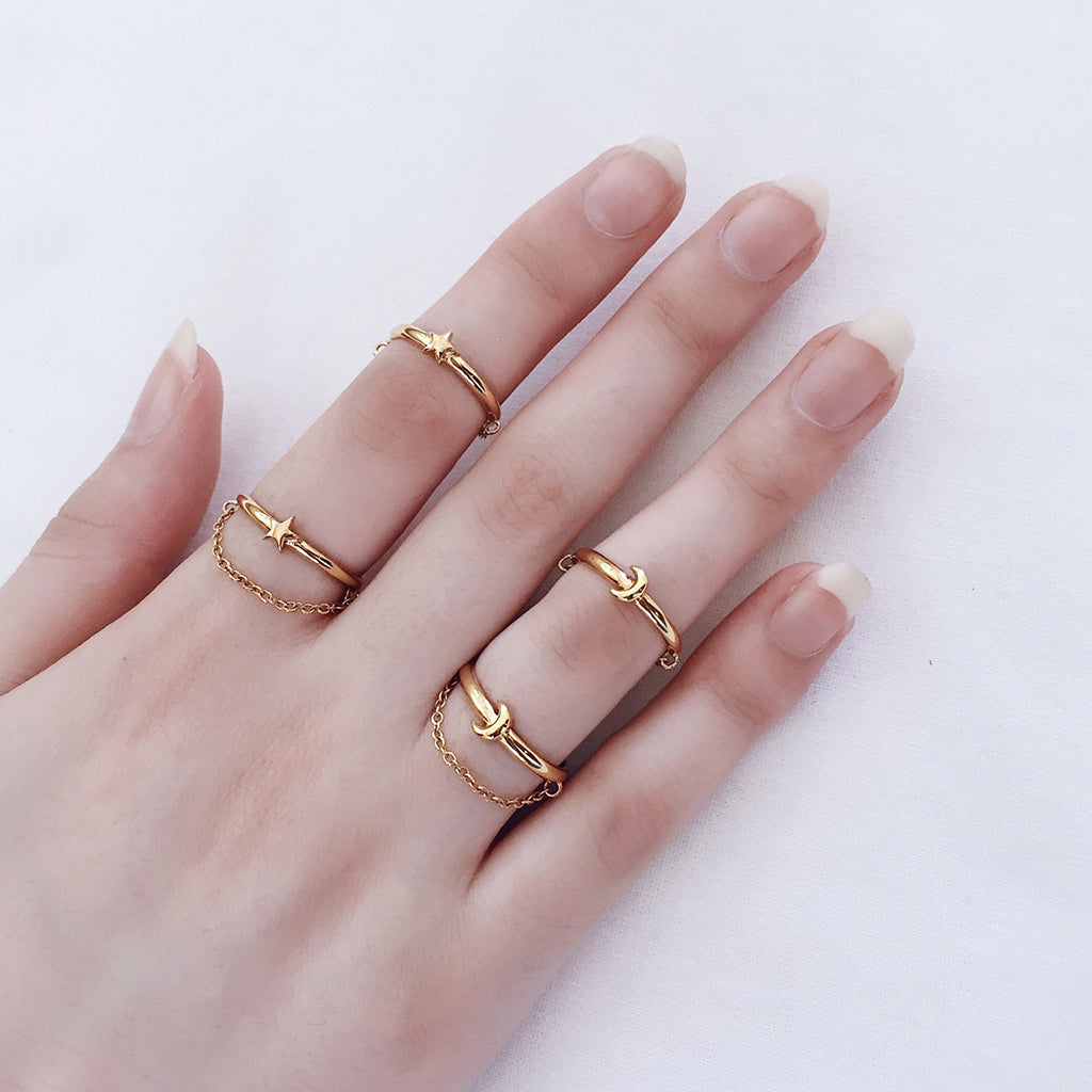star moon reversible chain rings in gold - unique star moon gold ring that can be worn in four 4 different ways, with the star and or chain on top, or reverse the ring and wear the moon with or without the chain on top