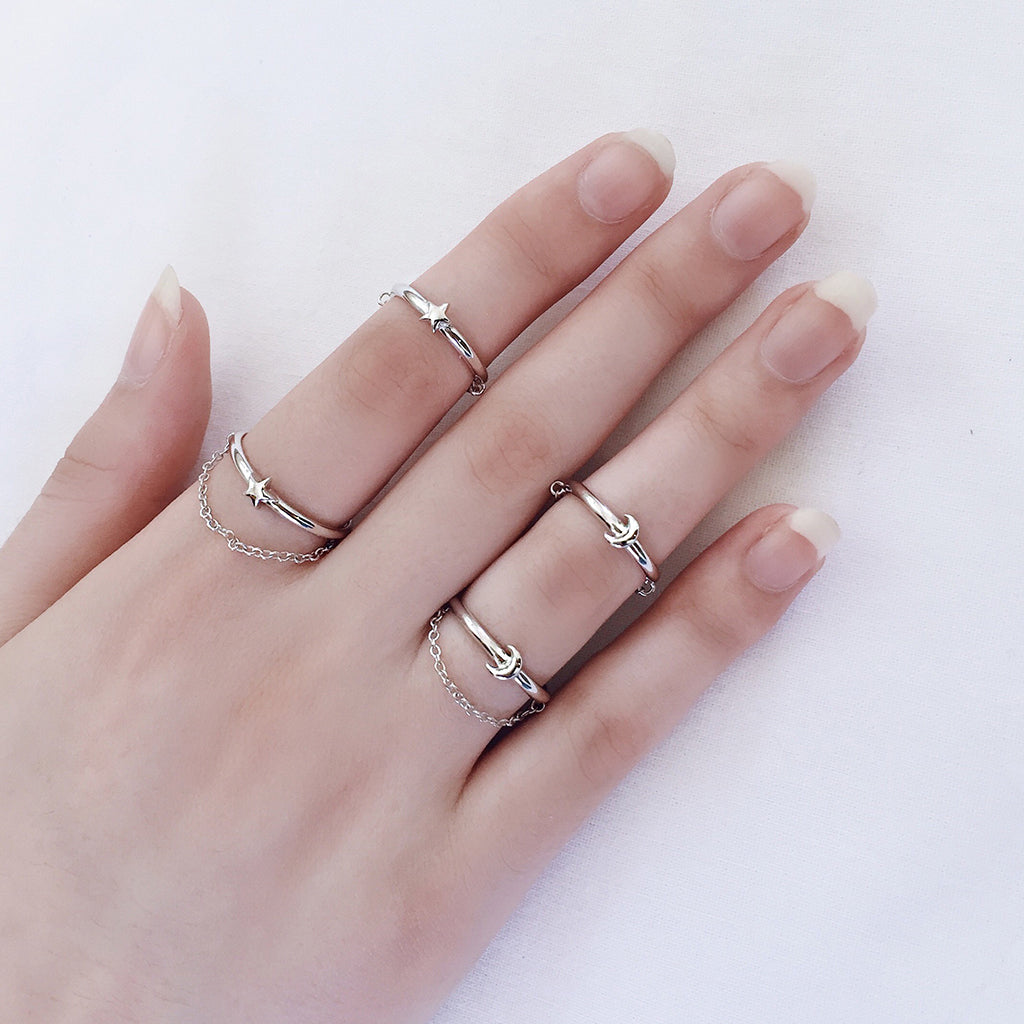 reversible silver star moon ring with fine chain - unique reversible ring design that can be worn in 4 different ways - with the star or moon on top, with the chain above or under the finger. sterling silver. great ring gift idea for girl, best friend, sister or girlfriend who loves to stack her rings. the 4 different ways in which you can wear this amazing ring.