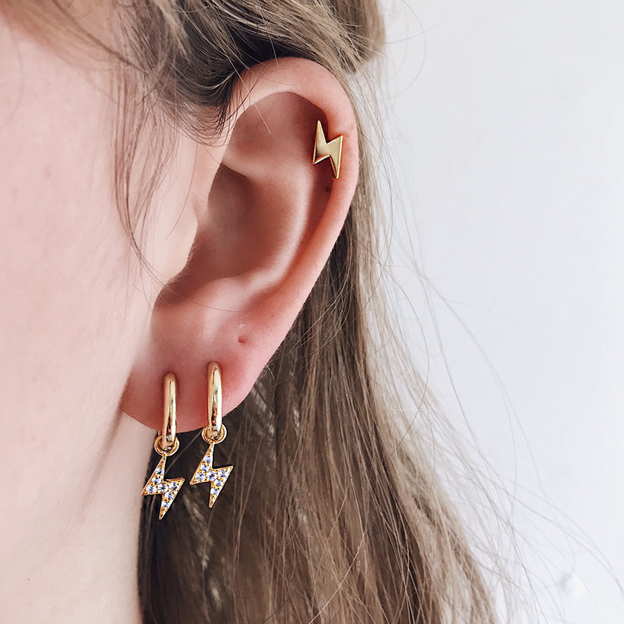 lightning bolt ear hoops in 14k gold studded with sparkling diamonds. modern minimal hoop earrings with lightning bolt design, fine womens jewellery. hypoallergenic great for sensitive ears ear piercings.