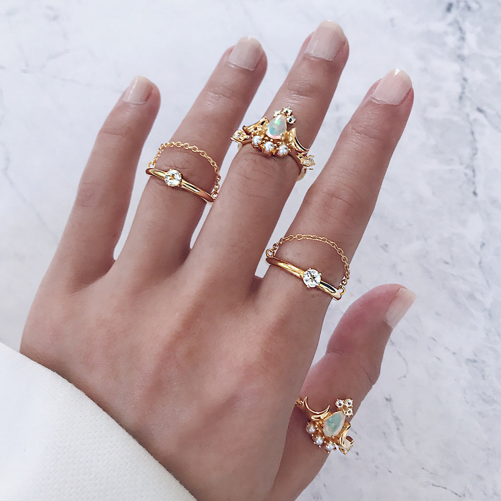 beautiful gold ring stack - create a one of a kind stacking rings display with white opal rings, diamond solitaire chain rings that give a bejewelled dazzling look and style