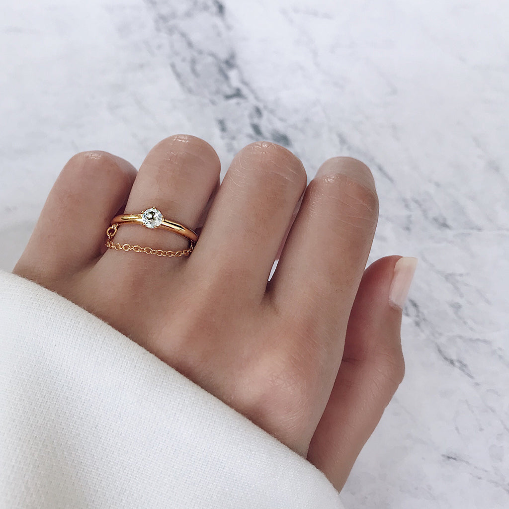 looking for a unique diamond ring - this solitaire ring comes with a fine chain that drapes gracefully across the finger. clever way of updating a classic engagement wedding ring idea, perfect for modern women who love fine gold jewellery