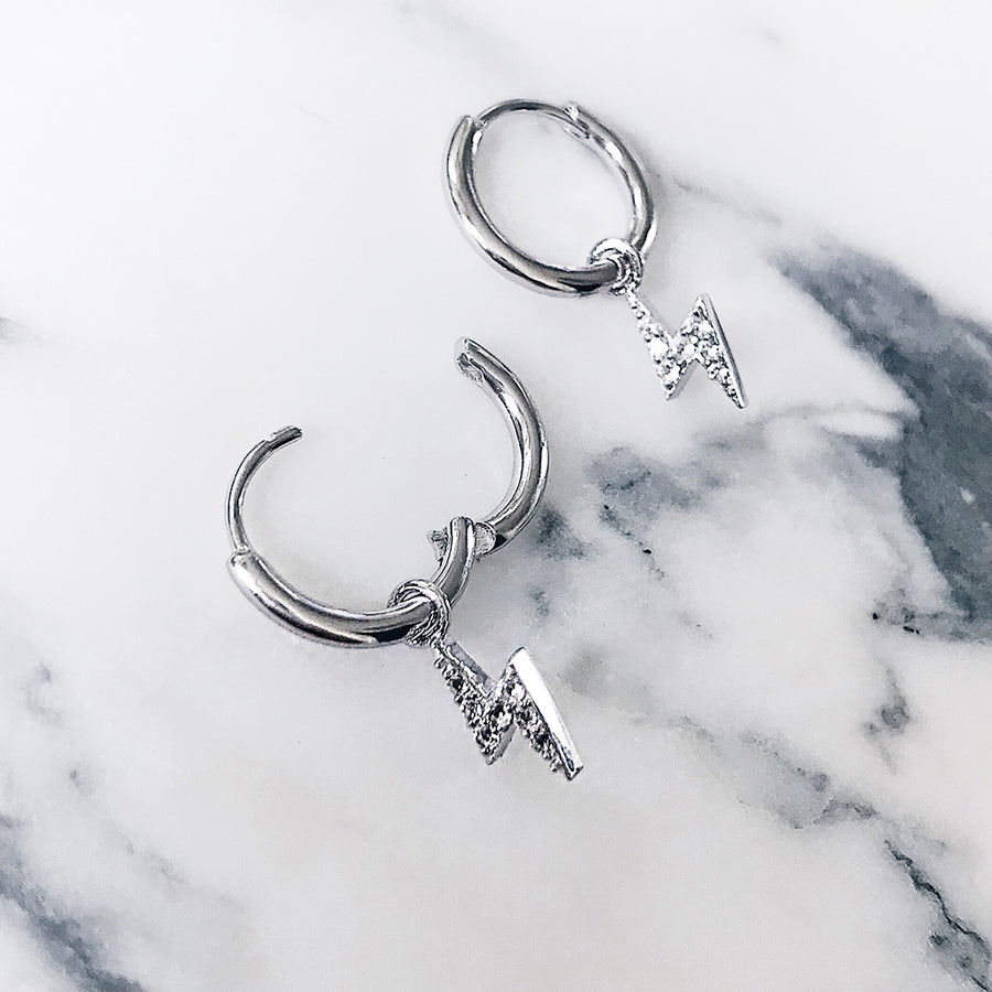 easy to wear hoop earrings design - with hinge opening that makes ear hoops easy to wear or remove / take off. sterling silver lightning bolt diamond ear hoops. hypoallergenic