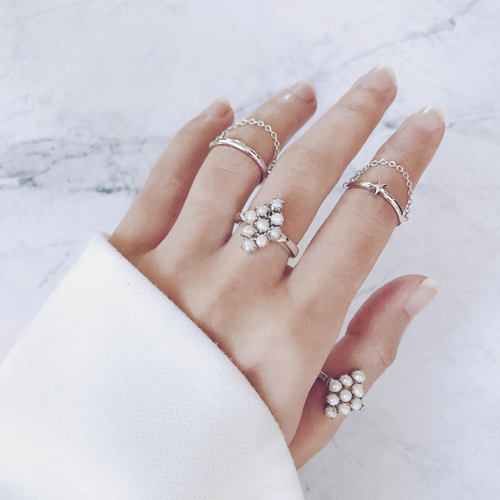 pearl ring cluster - Ring stack trend - Learn how to stack your rings with vintage pearl rings and fine silver chain rings to create a modern mix