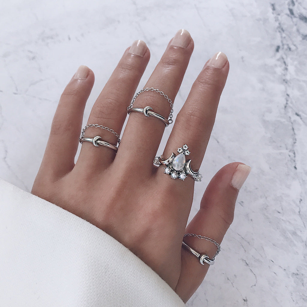 moon stacking rings with white opal cocktail ring with diamonds and pearls worn back with fine chain rings with crescent design - trendy boho ring stack that imbues white magic. Perfect gifts for Christmas, Valentine's Day and Mother's Day.