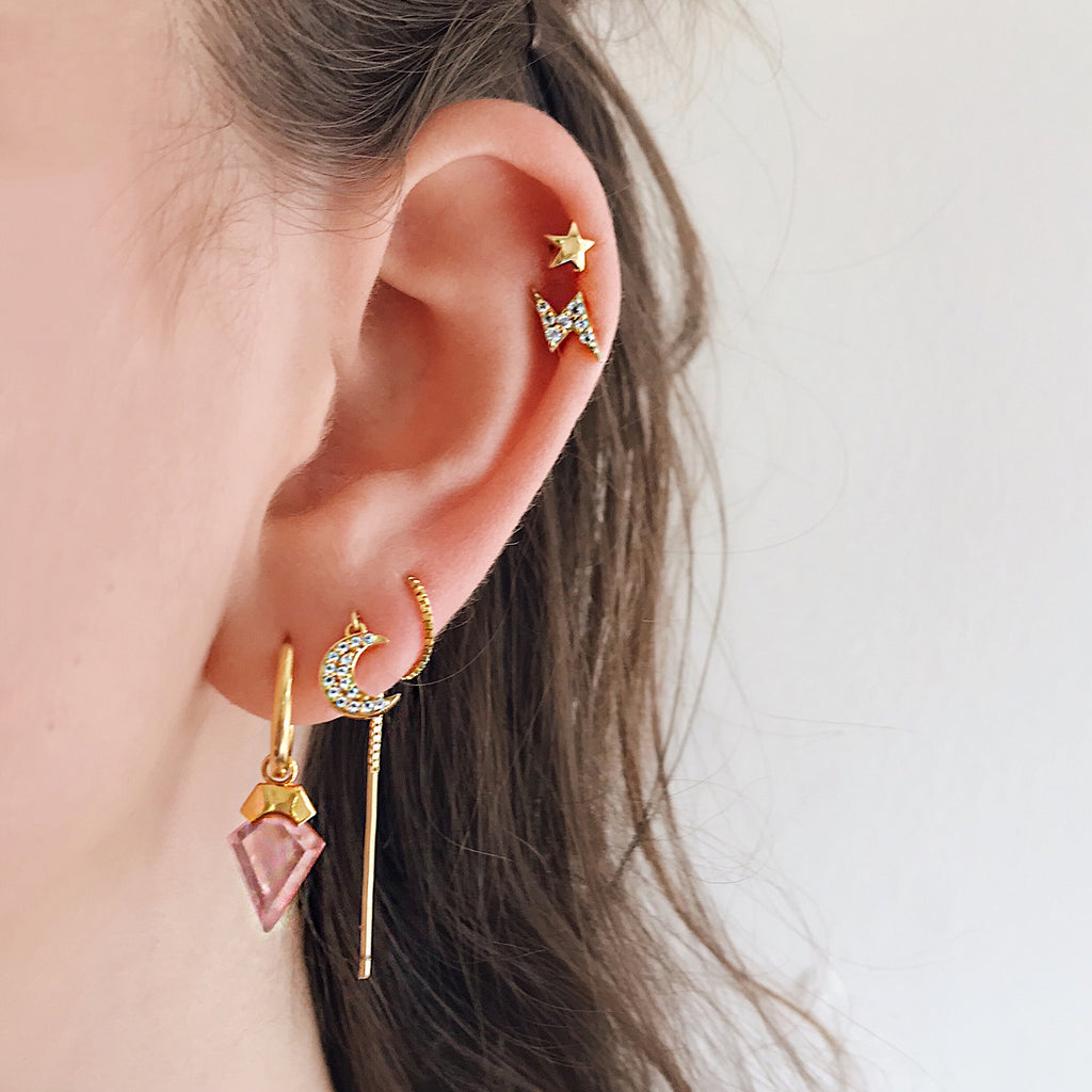 crescent moon diamond threader earrings 14k gold pave thread twisted through multiple piercings worn with rose quartz hoop earring and star thunderbolt gold studs