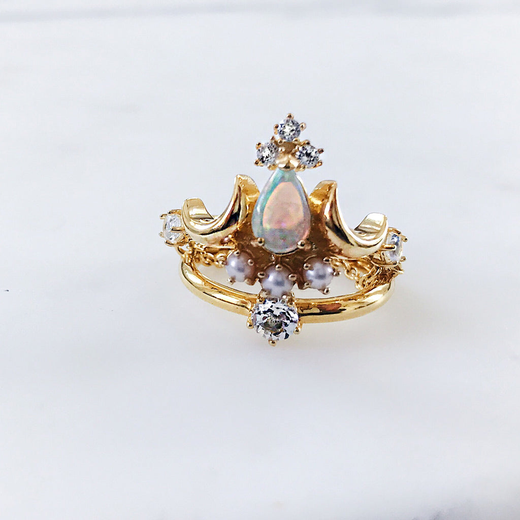 gold stacking rings - white opal pear cut tiara ring with diamonds and pearls stacked on a brilliant cut diamond solitaire ring - modern jewellery for fashionable women