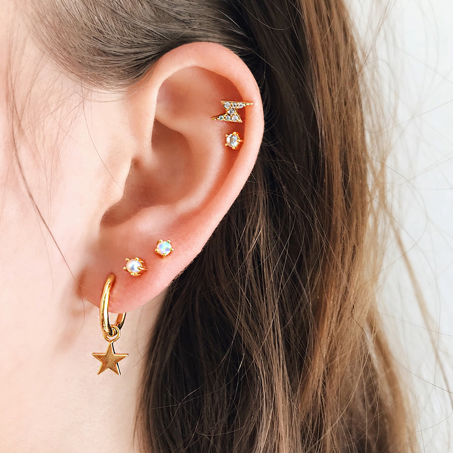 Star Moon Ear Hoops. Womens Gold Hoop Earrings. Hypoallergenic. Modern, beautiful hoop earrings adorned with a beautiful star and moon. Gold hoops to love, the perfect earring trend. A great everyday jewellery piece. Sterling silver with 14k gold. Perfect for sensitive ears and ear piercings. Easy to wear and remove.