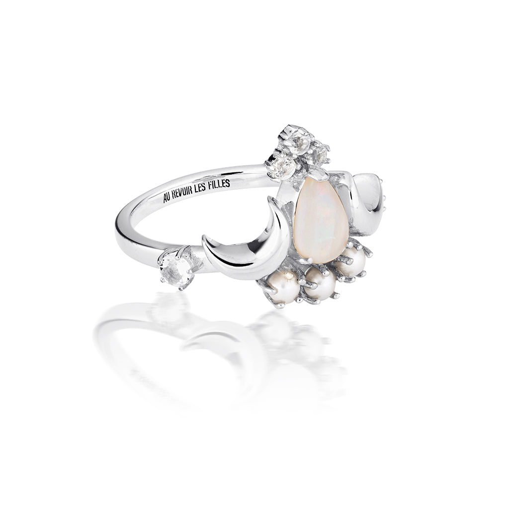 white opal ring in pear cut design with luminous cream pearls and sparkling white topaz flanked by twin crescent moons in a tiara crown ring design - beautiful cocktail silver ring in an antique heritage design