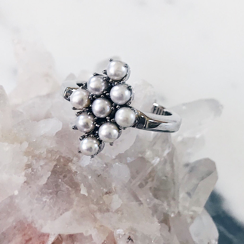 pearl ring - sterling silver - pearl cluster ring diamond shape - elegant classy vintage antique ring - womens fine jewellery - resting on beautiful jewellery display of rose quartz