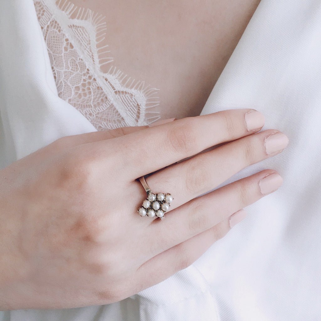 pearl cluster ring in diamond shape heritage antique setting. sterling silver. worn with beautiful white lace bra and classic white shirt