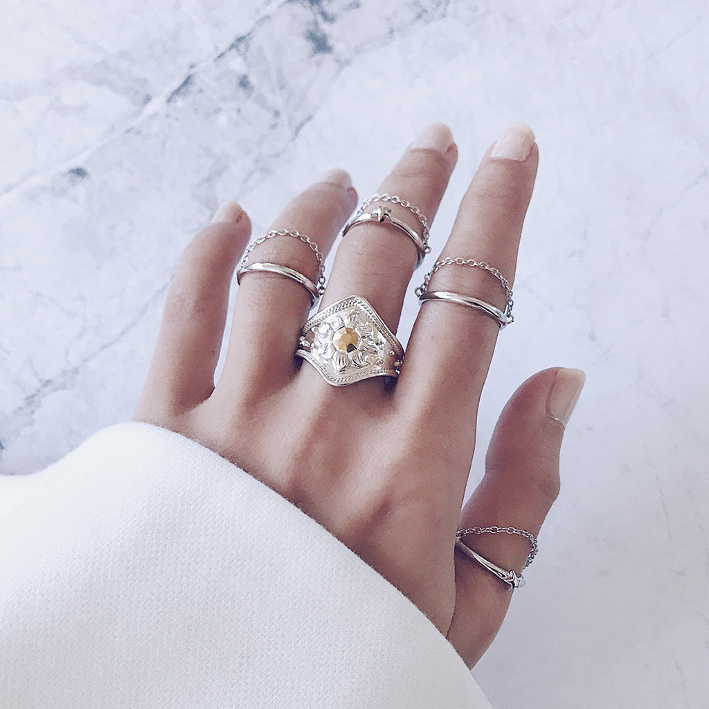 silver stacking rings in fine chain design or curved chunky ring - mix and match silver rings of different design to create a unique ring stack that is one of a kind. wear back with long white sleeves, perfect womens jewellery for winter and the ice snow queen