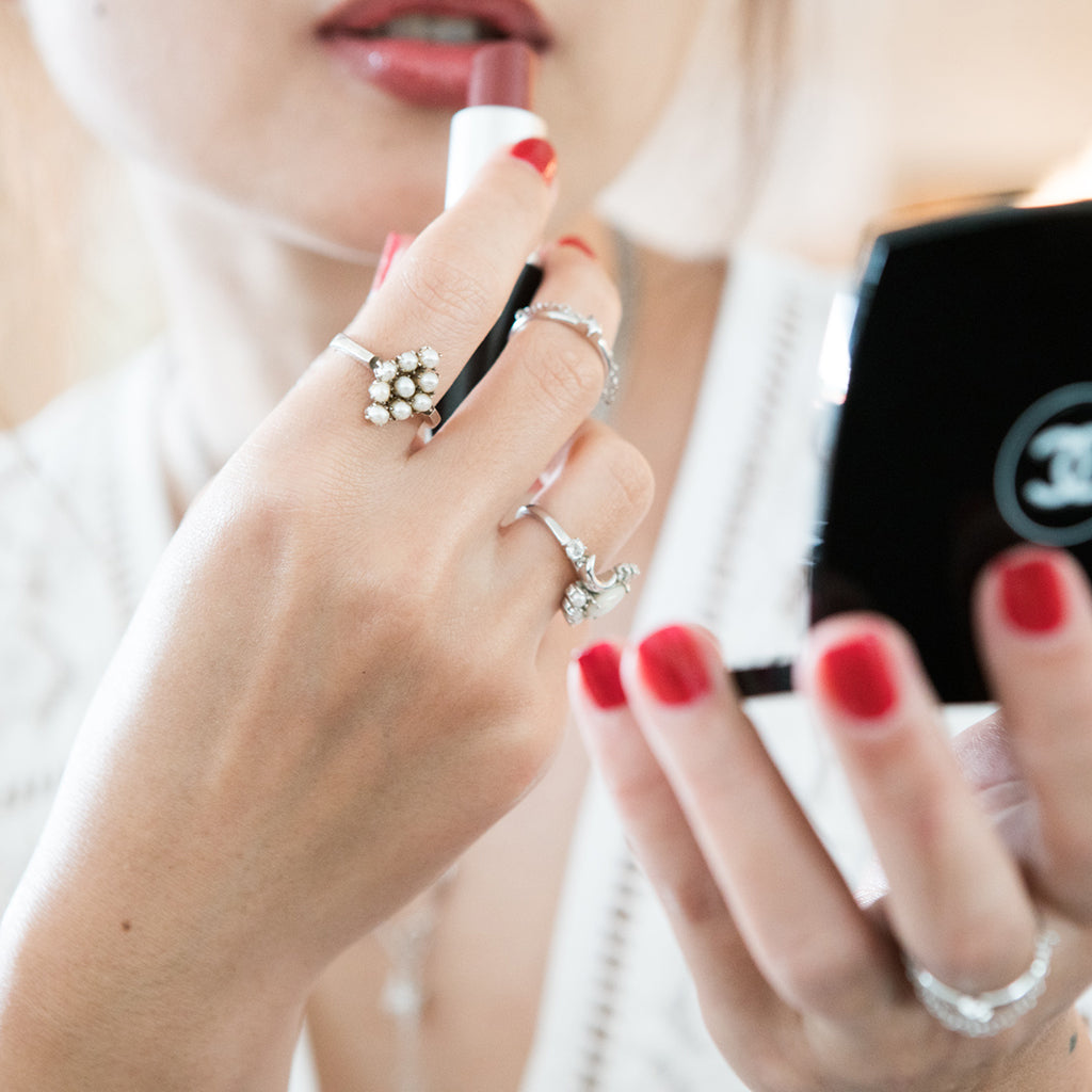 pearl ring stacking rings sterling silver - white lace dress worn with silver layering jewellery and chanel red nails