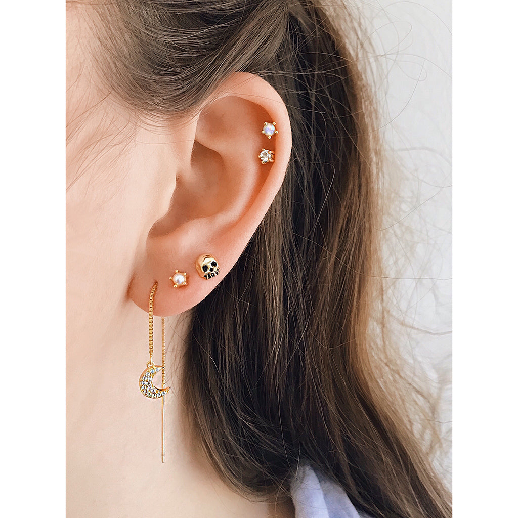 crescent moon diamond threader earrings 14k gold thread earring with small gold skull studs and pearl diamond Australian white opal ear stud