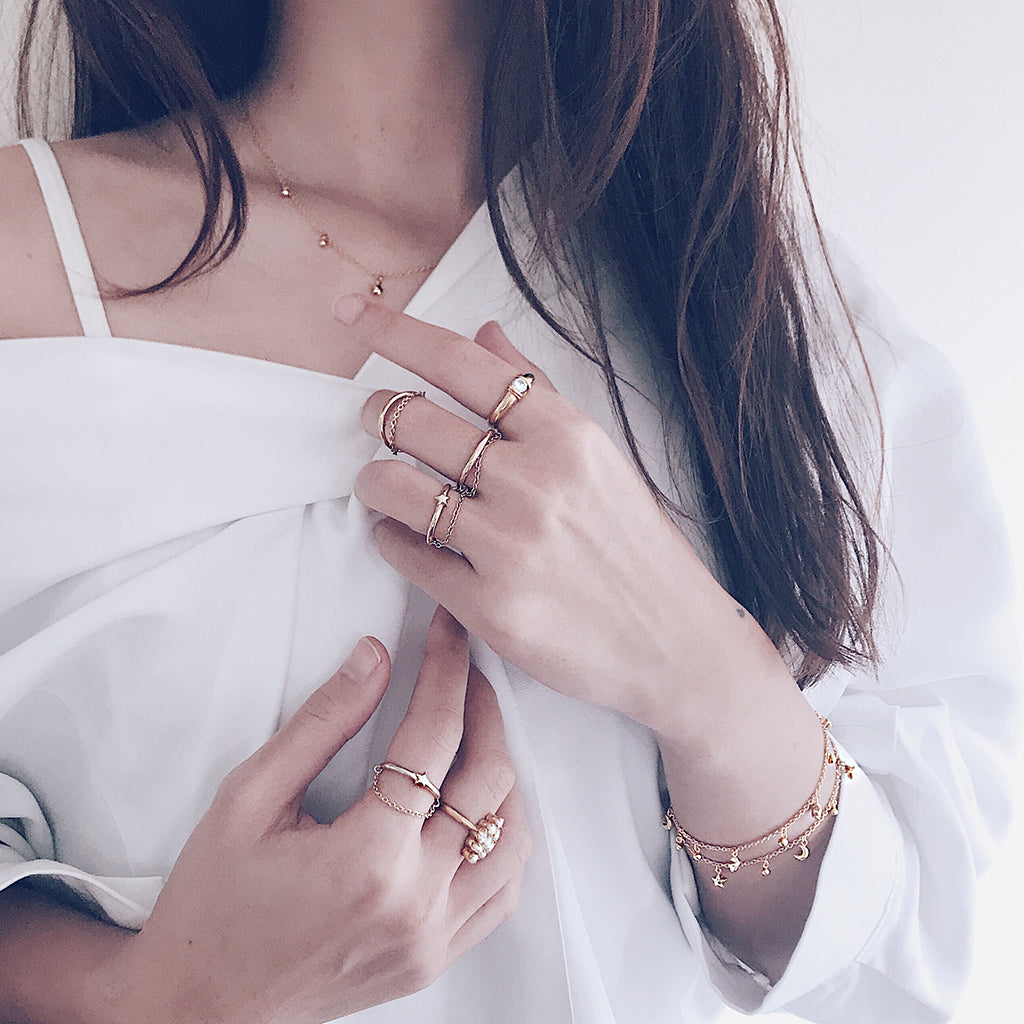 Star moon fine bracelets in 14k gold vermeil layered and worn with beautiful stacking gold chain rings and star necklace in a sensual, modern and effortless way. womens affordable fine jewellery, perfect as gifts for xmas and valentine's day