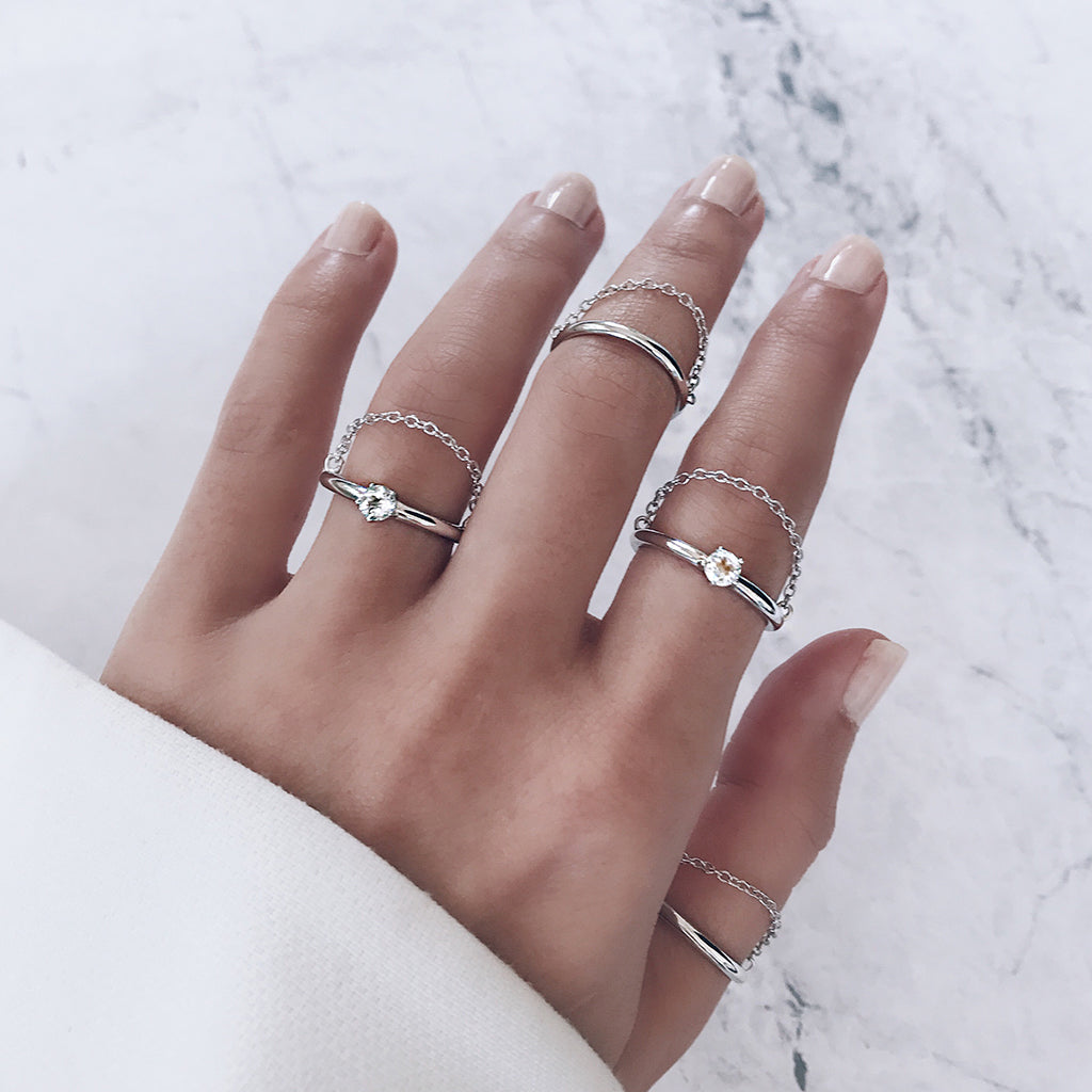 sparkling shiny diamond chain ring in sterling silver stacked together - perfect for the modern minimalist who loves minimal silver jewellery and rings