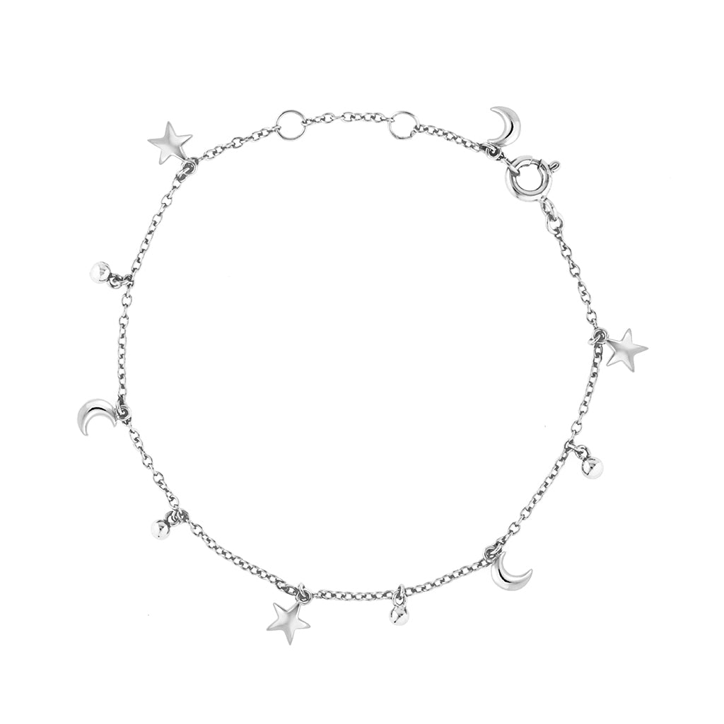 Star moon charms hanging on a fine chain bracelet in sterling silver, perfect for the modern star child and minimalist