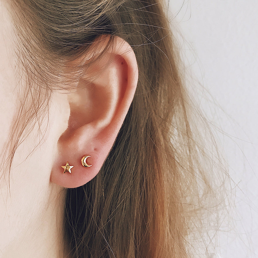 Tiny gold moon and star ear studs in a modern micro size. Perfect for the modern minimalist. Affordable fine jewellery