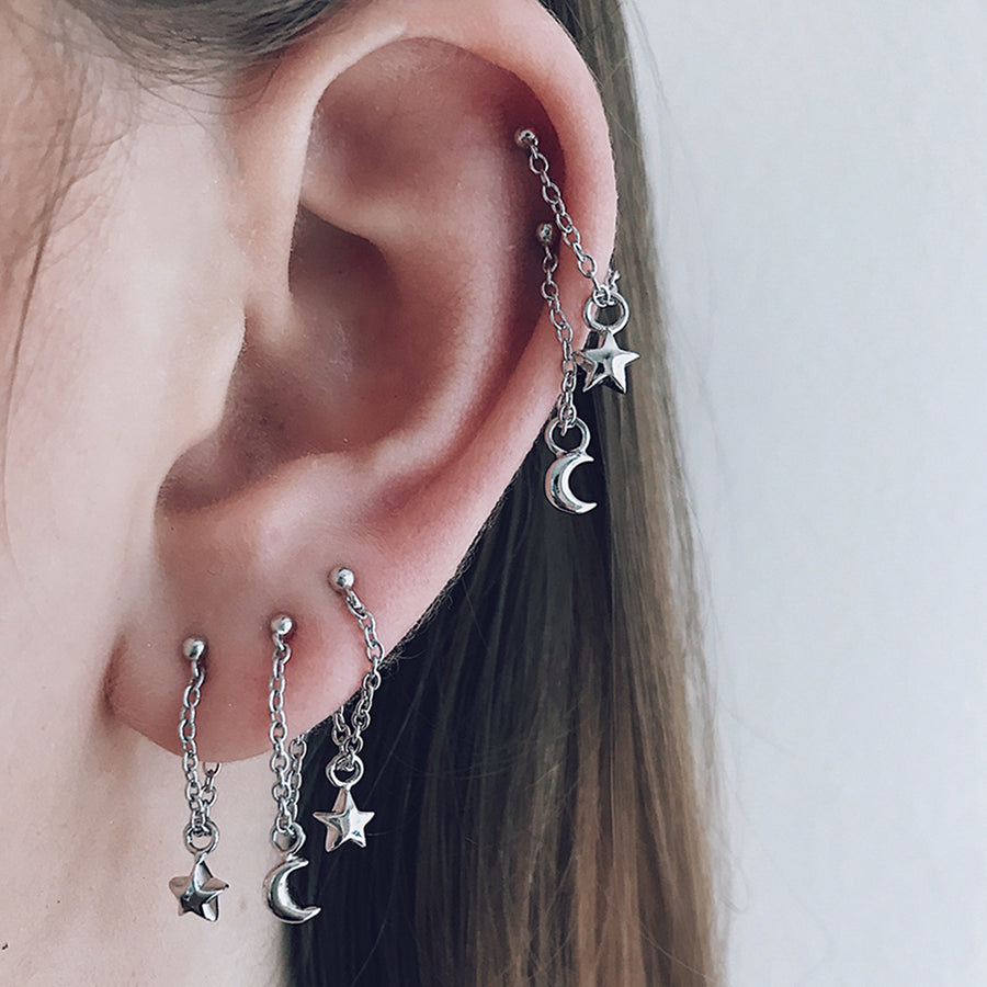 star moon dangling earrings in 925 solid sterling silver stacked together to create a beautiful earring display. magic ear candy and earring fashion trend. hypoallergenic, and perfect for sensitive ears and ear piercings.
