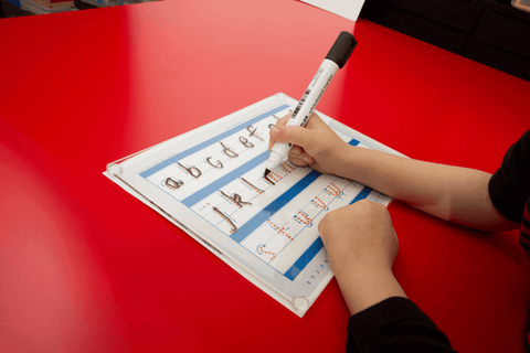 Child writing on the Writeboard, clear writing board for kids