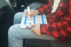 Our Writeboard Kit Tin being used as a Lap Table in the Car