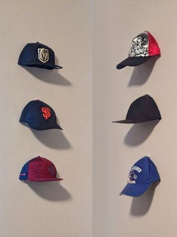 Baseball Cap Collection - Traci Farden.  Cap Capers make caps look like they are floating on wall.