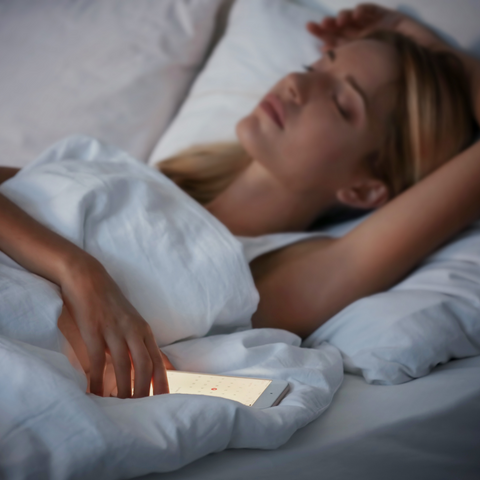 woman sleeping with a cell phone